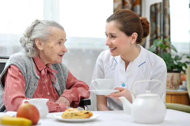 A elderly woman and a career chatting